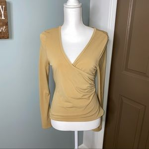 Surplice silky top with a little flare to sleeves